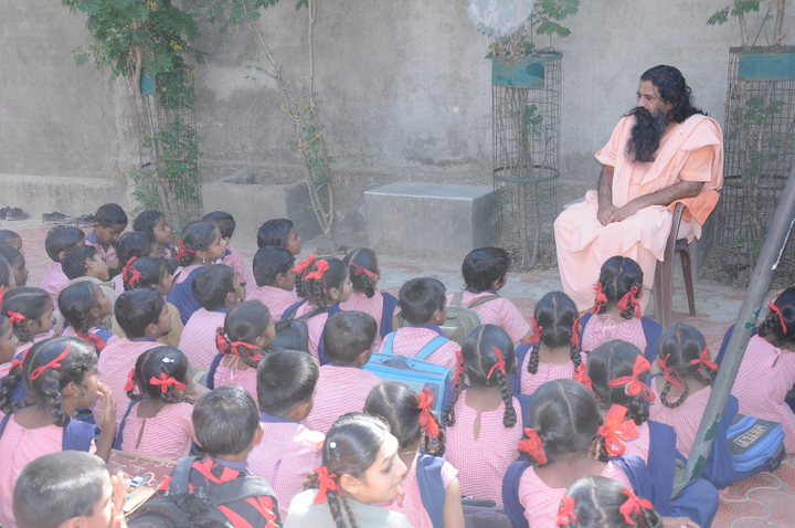 primary children sitting outside bapu